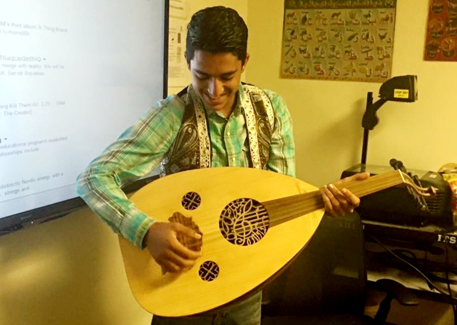 student playing the sitar